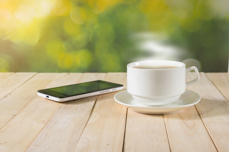 warm cup of coffee on nature background.