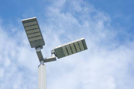 LED street lamps post on sky background. Standard-Bild