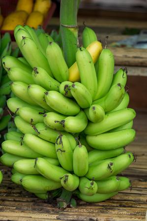Green bananas at the market