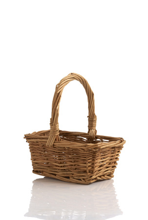 wooden basket on white background photo