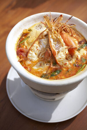 thai spicy shrimp soup in sun light Stock Photo