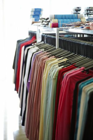 many shirts in shop on natural light photo