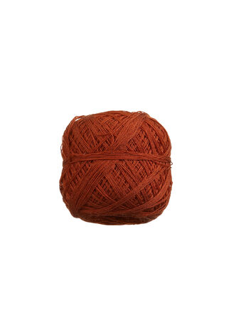 light brown yarn ball on white background photo