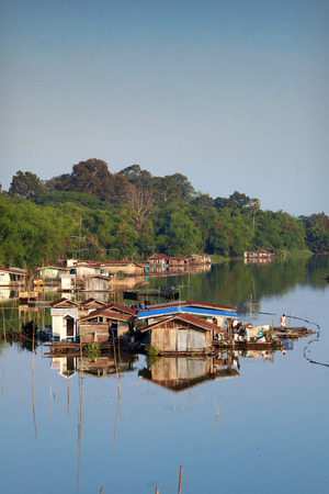 house boat and jungle in thailand photo