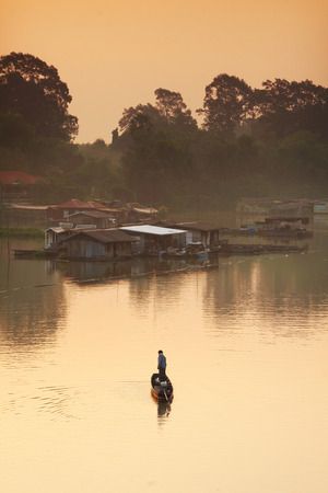 afloat: one man and one boat in morning light