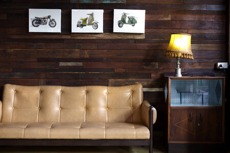 sofa and lamp in wooden house  photo