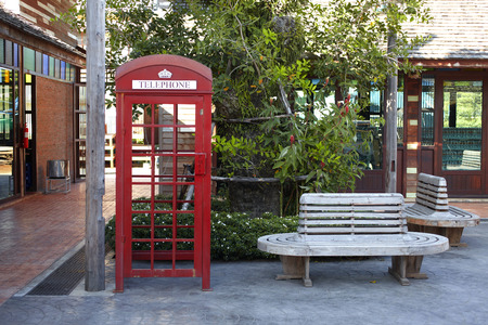 phone booth and wooden chair in thailand photo