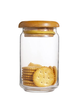 yellow biscuit in bottle on white background photo