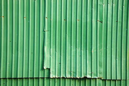 background from green metal wall in sun light photo