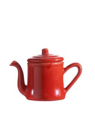 red kettle on white background photo