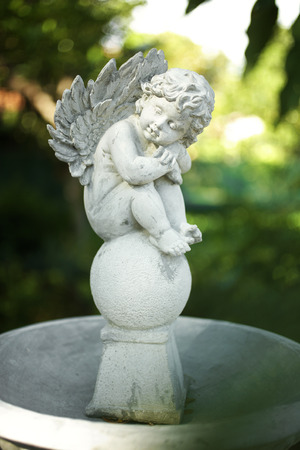 garden statuary: close up angel doll in garden Stock Photo