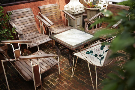 close up wooden chair in garden photo