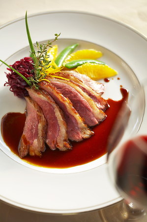 filets: close up duck grilled steak and sauce in white dish