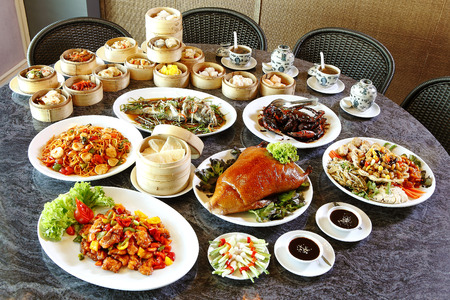 many chinese food on table in lunch time