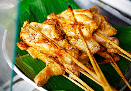 asian food: close up thai chicken barbecue in sun light