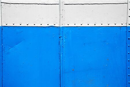 white metal: close up old blue and white metal wall Stock Photo