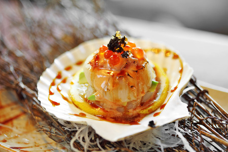 close up japanese scallop grilled and sweet sauce in sunlight