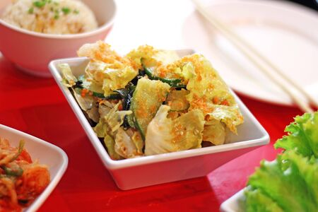 korean salad: close up spicy korean salad from cabbage in ceramic dish