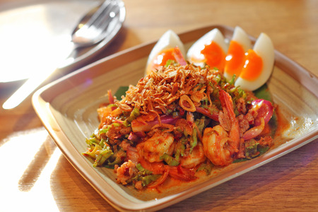 seafood: close up thai spicy seafood salad in ceramic dish Stock Photo