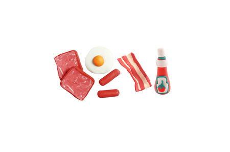 bacon art: miniature breakfast model from japanese clay on white background