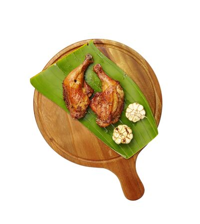grilled meat: thai chicken grilled with herb on wooden tray