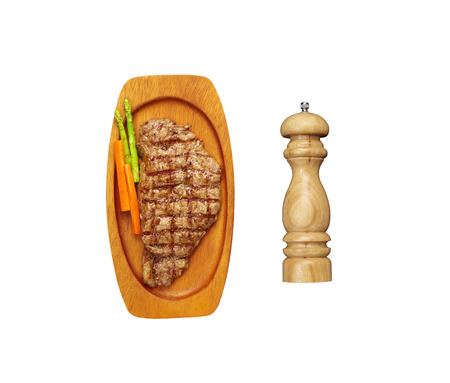 pepper grinder: beef steak and vegetable and pepper grinder in wooden tray