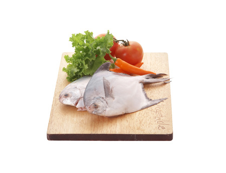vegetable tray: fish and vegetable in wooden tray on white background