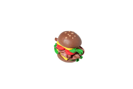 bacon art: miniature cheese burger model from japanese clay on white background