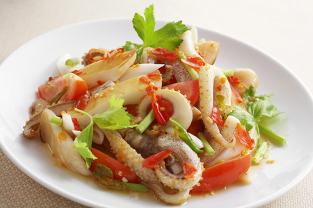 close up thai spicy seafood salad in ceramic dish Stock Photo