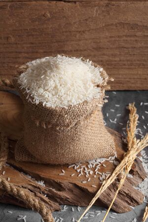 thai white jasmine rice in sack bag in kitchen with a blank space for a text, thai agriculture concept