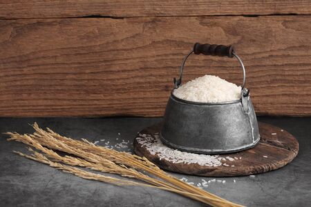 thai white jasmine rice in metal bowl in kitchen with a blank space for a text, thai agriculture concept