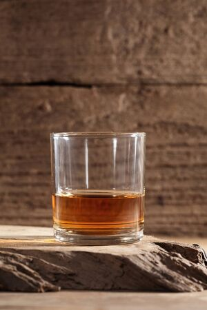 scotch whiskey in glass on a wooden table with a blank space for a text, scotch whiskey in rustic bar background Stockfoto