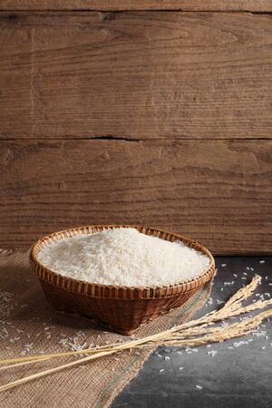 thai white jasmine rice in wooden basket in kitchen with a blank space for a text, thai agriculture concept