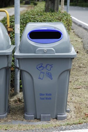 blue and gray recycle bins with recycle symbol in public park Stock fotó