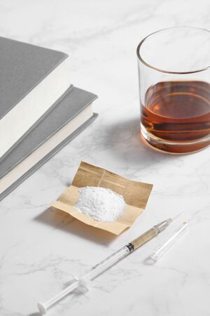 cocaine in paper and equipment on marble background with a blank space for a text, Background from cocaine party