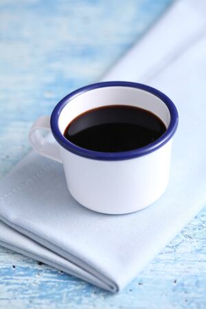 Coffee in white cup on rustic table with a blank space for a text, Espresso in cup on blue background