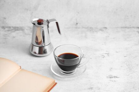 Coffee in cup and books on rustic table with a blank space for a text, Espresso in cup on white background Stockfoto