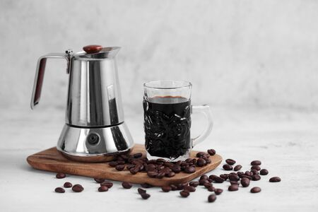 Coffee in cup and moka pot on rustic table with a blank space for a text, Espresso in cup on white background