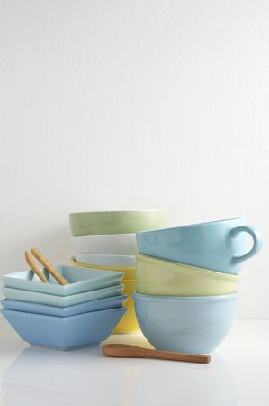 Group of various color pastel bowl on white table with a blank space for a text, bowl on white background