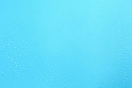 Close up water drops on blue background, Water drop in macro photography Stock Photo