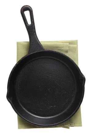 Empty iron pan and napkin isolated on white background