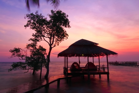 chang: Hut and coconut tree silhouette at sunset, Chang island, Thailand