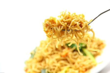 instant noodles: picture of fried noodles with vegetables on white background. Stock Photo