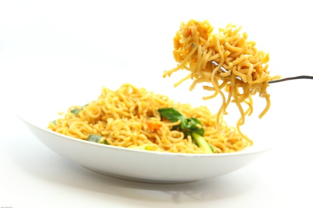 eating noodles: picture of fried noodles with vegetables on white background. Stock Photo
