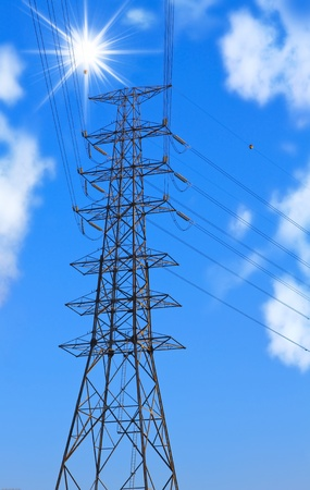 Picture of electric post on blue sky and sun. photo