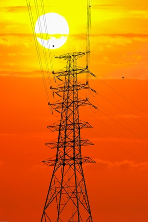Picture of electric pole and sunset  silhouette. photo