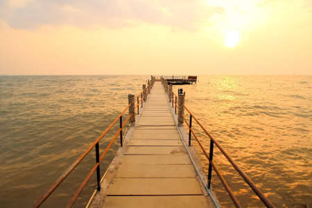 Picture of the bridge and sunset on the sea  photo