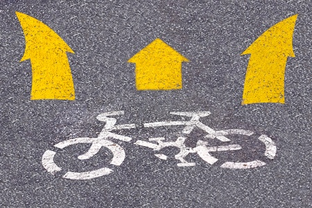 picture of white painted sign for bikes lane. photo