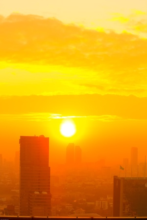 Sunrise in the foggy day at Bangkok city, Thailand photo