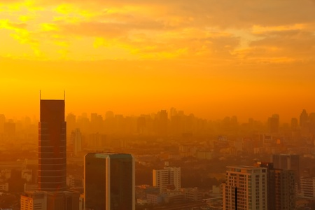 Sunrise in the foggy day at Bangkok city, Thailand photo